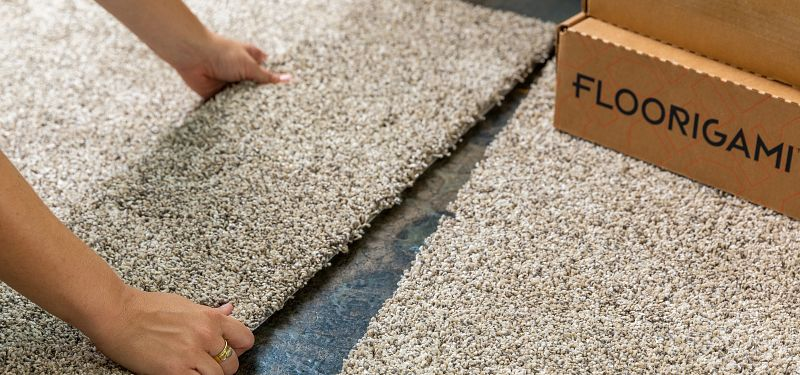 Image of Floorigami carpet tile being installed on the floor
