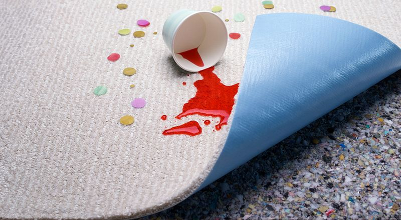 image of carpet pulled back to show lifeguard spill-proof carpet backing